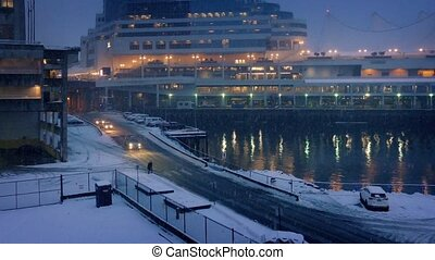 City Harborside Scene With Snow Falling In The Evening
