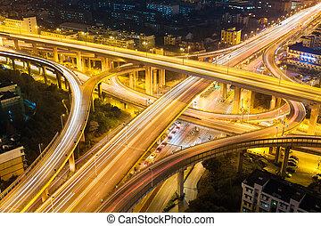 city highway overpass at night