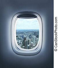 city in  porthole - city in the aircraft's porthole