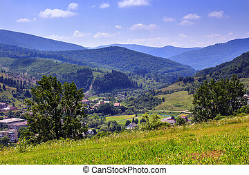 city in summer mountain valley - summer landscape. view from...