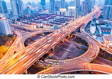 city interchange closeup at busy nightfall