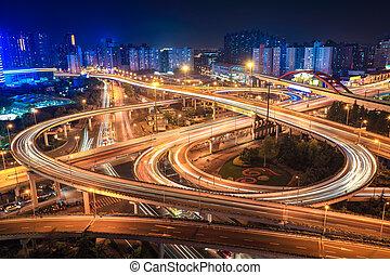 city interchange overpass at night in shanghai