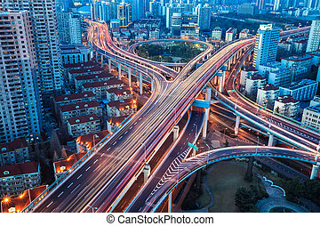 city interchange bridge closeup with beautiful tail lights in nightfall