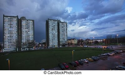City life and clouds Cloudy Sky in Sunset time lapse