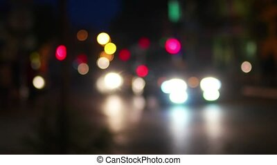 City life in the night defocused shot. Blurred cars and...