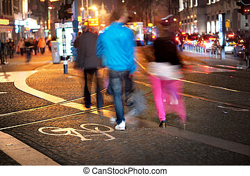 City life - Three people in blurred motion in city in...