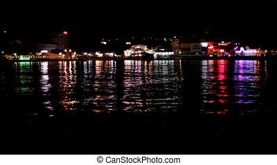 City lights - A beautiful night city on the coast.
