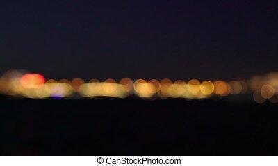 City lights blur at night