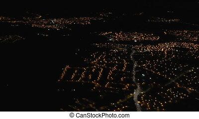 City lights from landing aircraft