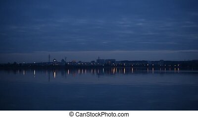 City lights reflected in water in the evening