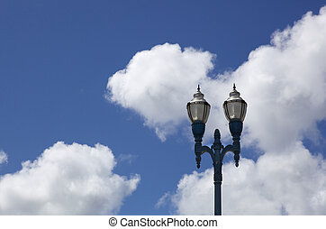 City lights sky clouds - Old city style lamp post with two ...