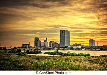 A panoramic view of downtown Toledo Ohio's skyine at sunset from across the Maumee river. Processed with HDR software.