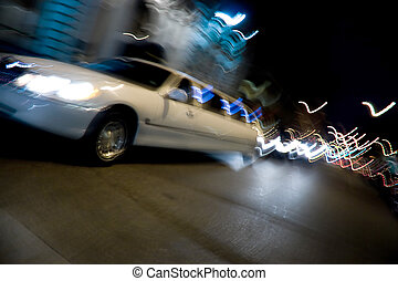 City Limo at Night - An abstract blur of a white limousine...