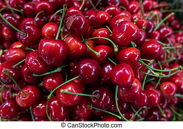 City market stall with fresh red cherries.