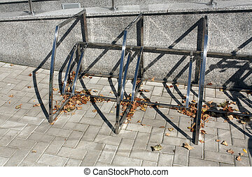 City metal bicycle parking lot in autumn.