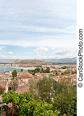 The city Nafplion with houses and roofs near the harbor in the Argolic gulf