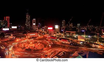 City Night Lights Traffic Lights around Circle from Skyscraper