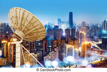 City night view and satellite dish - Night, city skyline and...