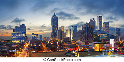 Panoramic image of the Atlanta skyline during sunrise.