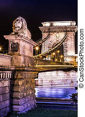 City of Budapest in Hungary night urban scenery, street on the Szechenyi Chain Bridge (Hungarian: Szechenyi lanchid).