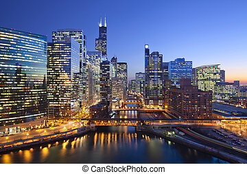 Image of Chicago downtown and Chicago River with bridges during sunset.