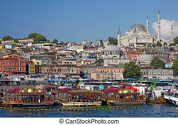 City of Istanbul in Turkey, Eminonu district, on the left New Mosque (Turkish: Yeni Valide Camii)