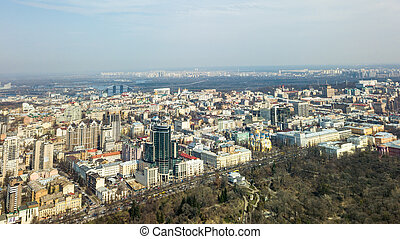 City of Kiev on a sunny day. Modern high-rise buildings and a park. Aerial photo from the drone