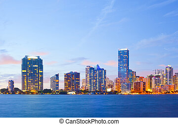 City of Miami Florida, colorful night panorama of downtown business and residential buildings