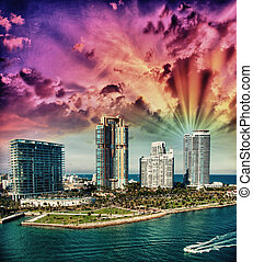 City of Miami Florida, colorful night panorama of downtown business and residential buildings.