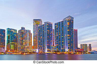 City of Miami Florida, night skyline. Cityscape of residential and business buildings illuminated at sunset