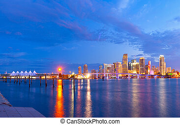 CIty of Miami Florida, summer sunset panorama with colorful illuminated business and residential buildings and bridge on Biscayne Bay