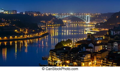 City of Porto and Gaia at night by the Douro river timelapse in Portugal, Arrabida Bridge at the far end.