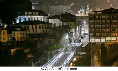 City of Porto by night timelapse in Portugal, the Old Town and Ponte Dom Luiz I arch bridge over Douro river.