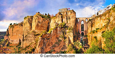 Panoramic view of the old city of Ronda, one of the famous white villages, at sunset in the province of Malaga, Andalusia, Spain