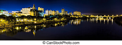 The city lights along the river in Saskatoon, Canada