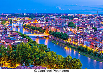 City of Verona and Adige river evening aerial view, tourist destination in Veneto region of Italy