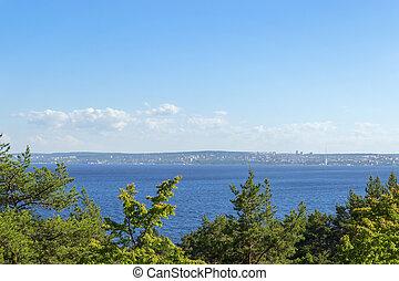City on coastline of lake bay