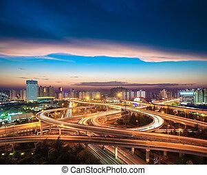 city overpass at nightfall - beautiful city interchange...