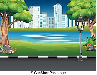 City park landscape with river and urban background