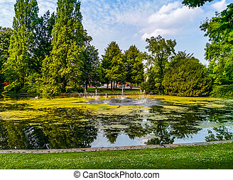 city park Valkenberg of breda with the pond and water fountains, Nature scenery of the Netherlands