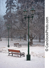 city park with benches and lantern in hoarfrost. wonderful...