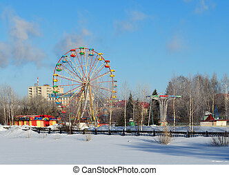 City park with entertainments in the winter