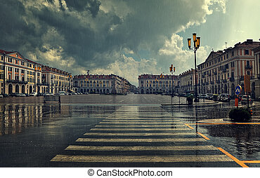 City plaza at rainy day in Cuneo, Italy. - Pedestrian...