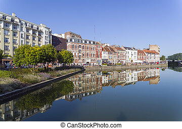 City pond. Lille, France. - Reflection of coastal buildings ...