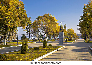 City Quay in the fall. Emptiness. Monument in the background and orange trees.