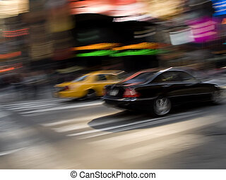City Race - A motion blur photo of a speeding taxi cab and a...