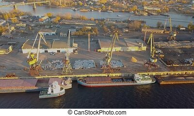 City River port - City port with crane loading cargo on...