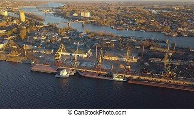 City River port - City port with crane loading cargo on...