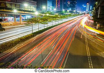 city road at night on rush hour traffic
