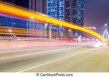 city road at night with dramatic light trails